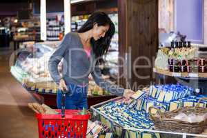 Woman selecting dairy products in grocery section