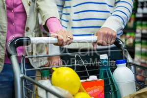 Couple shopping in grocery section at supermarket