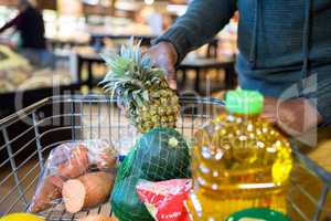 Man buying goods in grocery section