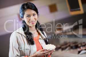 Portrait of woman holding sweet food