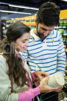 Couple buying goods in organic section