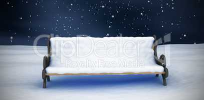 Composite image of snow covered park bench