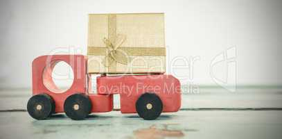 Toy tempo carrying christmas present against white background