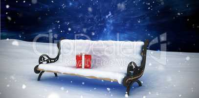 Composite image of digital generated image of gift boxes on park bench