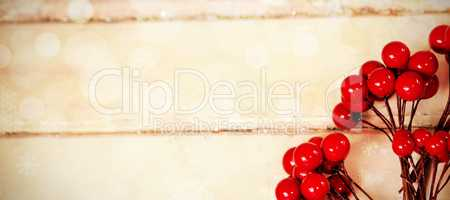 Fake red cherries on a plank
