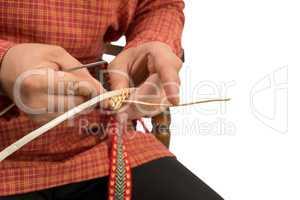 Wickerwork. Studio photo of craftsman makes basket