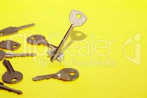 Keys Concept On Yellow