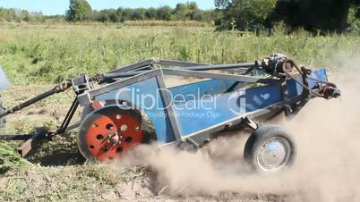 special equipment on a tractor for digging the potato