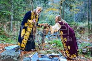 The old king, a queen and a small hunting dog