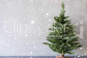 Christmas Tree With Cement Wall As Background, Snowflakes, Copy Space