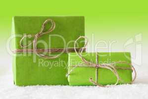 Two Gifts Or Presents On Snow, Green Background