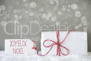 Gift, Cement Background With Bokeh, Joyeux Noel Means Merry Christmas
