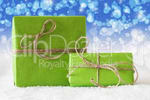 Two Green Gifts On Snow, Blue Bokeh Effect