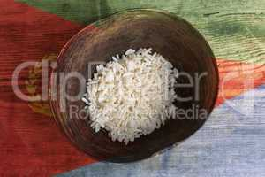 Poverty concept, bowl of rice with Eritrea flag
