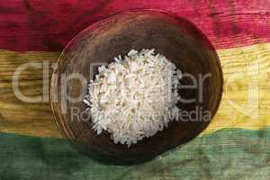 Poverty concept, bowl of rice with Ghana flag