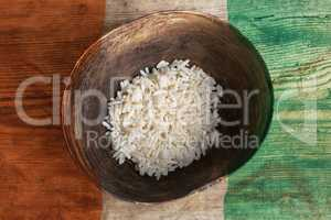 Poverty concept, bowl of rice with Ivory Coast flag
