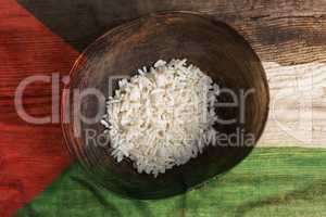 Poverty concept, bowl of rice with Palestine flag