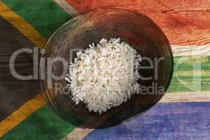 Poverty concept, bowl of rice with South Africa flag