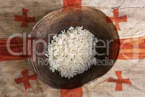 Poverty concept, bowl of rice with Georgia flag