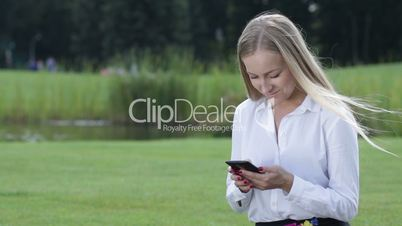 Young businesswoman working with cellphone outdoor