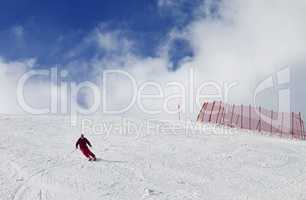 Skier on ski slope at nice sun day