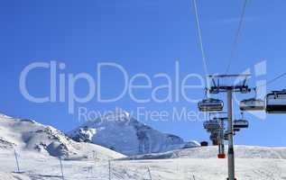 Ski-lift at ski resort in sun cold morning