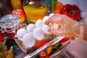 Chicken eggs on a shelf open refrigerator