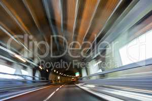 Motion Blur Driving Car at Speed Through a Tunnel