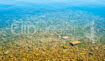 Transparent shallow water with rocky bottom.