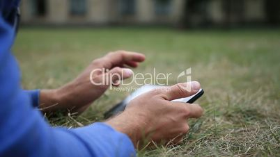 Male hands with digital tablet touching the screen