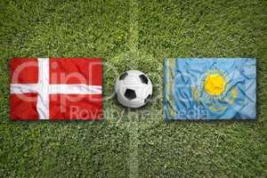 Denmark vs. Kazakhstan flags on soccer field