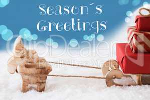 Reindeer, Sled, Light Blue Background, Text Seasons Greetings