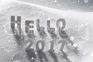 Text Hello 2017 With White Letters In Snow, Snowflakes