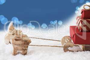 Reindeer With Sled, Blue Bokeh Background, Copy Space