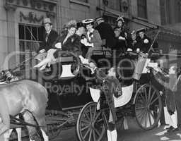Wealthy group of people in horse drawn carriage