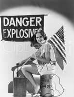 Portrait of woman with American flag and explosives