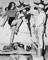 Dancing woman posing for mural painter
