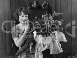 Woman with bouquet of flowers
