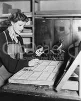 Woman working in printing shop