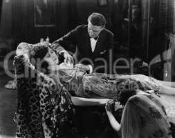 Man tending to injured woman