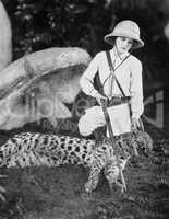 Female hunter with dead leopard