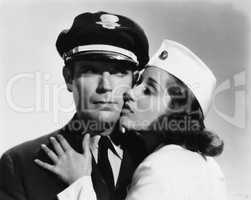 Pilot and stewardess having romantic moment