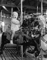 Toddler on carousel