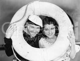 Portrait of sailor and sweetheart with life preserver