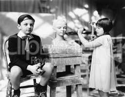 Boy and girl in an artist studio