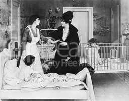 A woman with her nanny and two children in a bedroom talking with each other