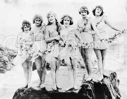 Six women posing at the beach