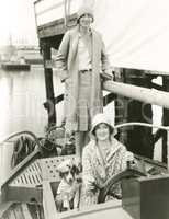Two women out sailing with their mascot
