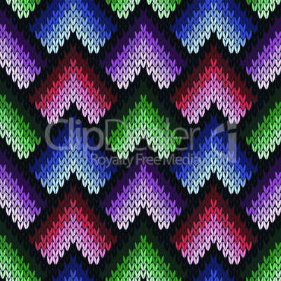 Abstract ornate knitting seamless pattern in various colors