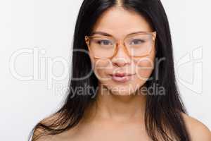 Beautiful Korean woman in glasses in studio